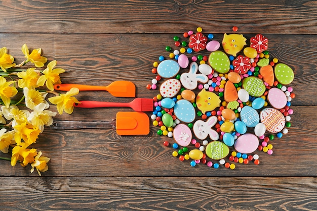 Colorful easter cookies and spatulas on table.