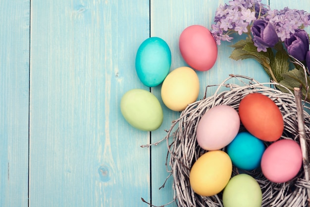 Colorful easter decarations on wooden plank