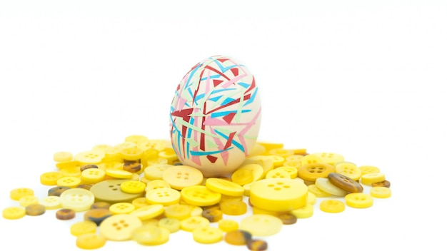 Colorful easter egg standing on the yellow button, easter concept background