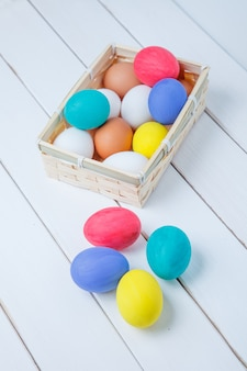 Colorful easter eggs in basket background
