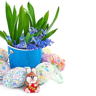 Colorful easter eggs in a basket on a white