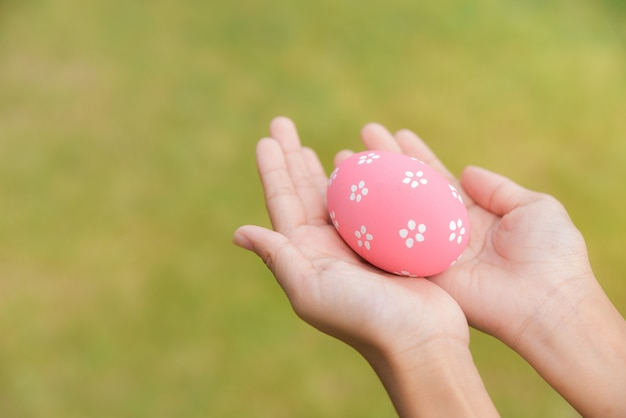 Colorful easter eggs in children hands after egg hunting.