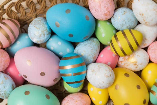 Colorful easter eggs in different sizes, close-up.