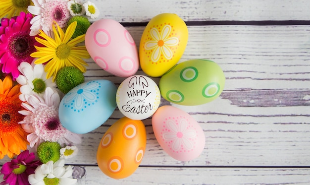 Colorful easter eggs and fresh flowers background