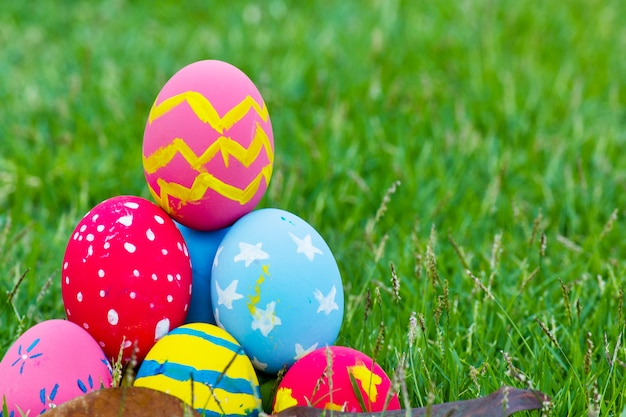 Colorful easter eggs in the grass on the green