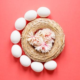 Colorful easter eggs in hay basket