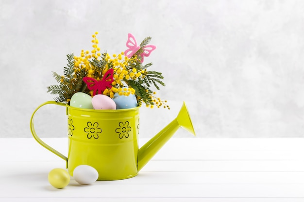 Colorful easter eggs and mimosa flowers