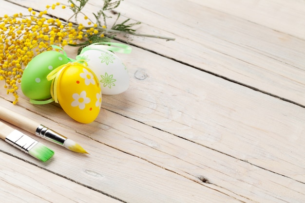 Colorful easter eggs and paint brushes