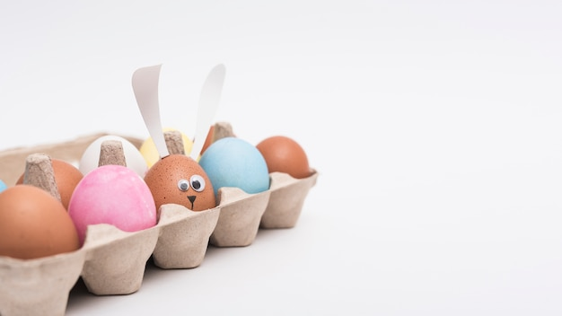 Colorful easter eggs in rack on table