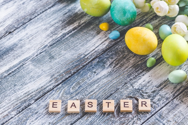 Colorful easter eggs on shabby blue wooden background and