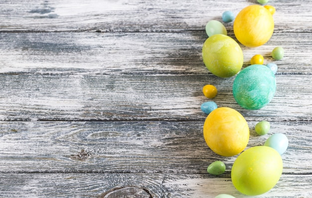 Colorful easter eggs on shabby wooden blue background