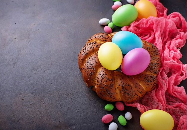 Colorful easter eggs and wicker bread