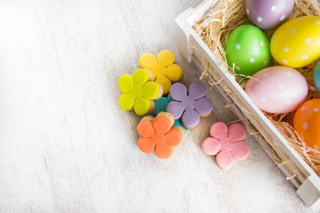 Colorful easter eggs in wooden box and homemade fondant