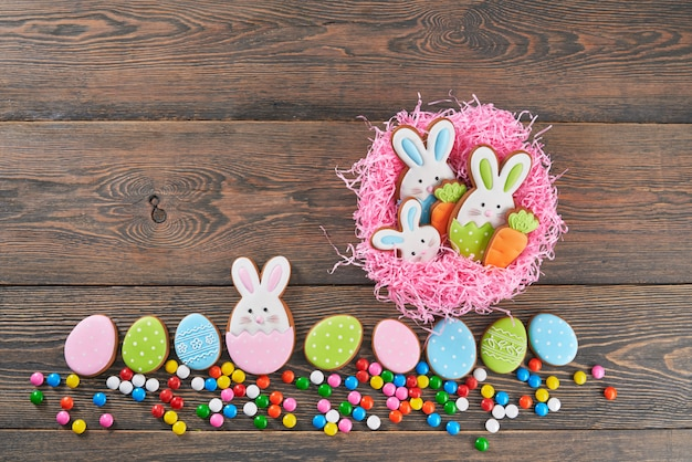 Colorful easter ginger cookies in nest.