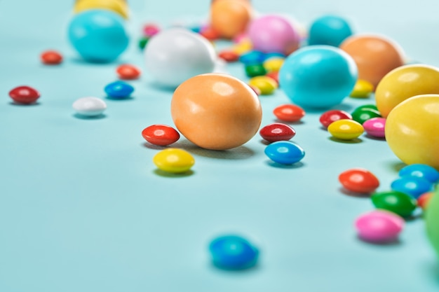 Colorful easter sweets on light blue background