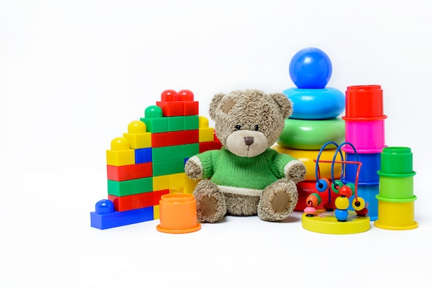 Colorful educational toys for children on a white surface