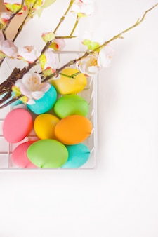 Colorful eggs for easter day in a basket.