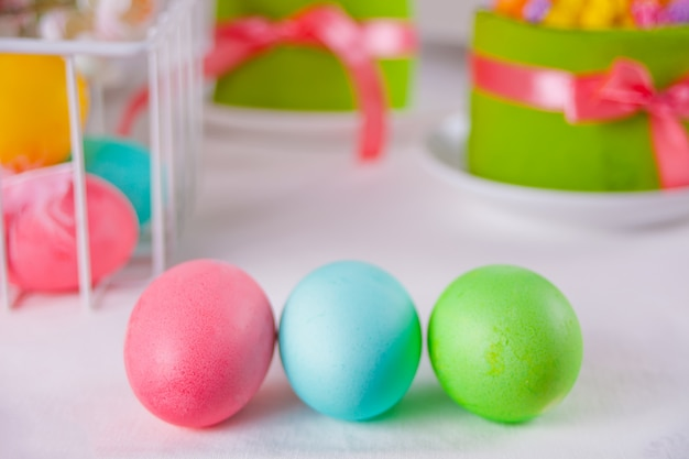 Colorful eggs for easter day, gift box and small cake
