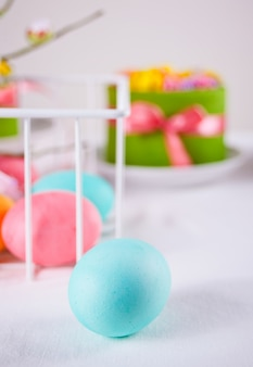 Colorful eggs for easter day and small cake
