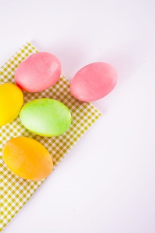 Colorful eggs for easter day. top view. copy space.