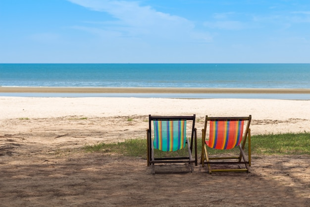 Colorful empty red and blue deckchairs on the beach, chair on the thailand beach
