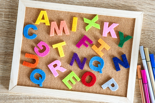 Colorful english  alphabet on a pin board background