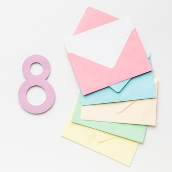 Colorful envelopes on white background