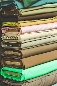 Colorful fabric cotton rolls in textile shop industry