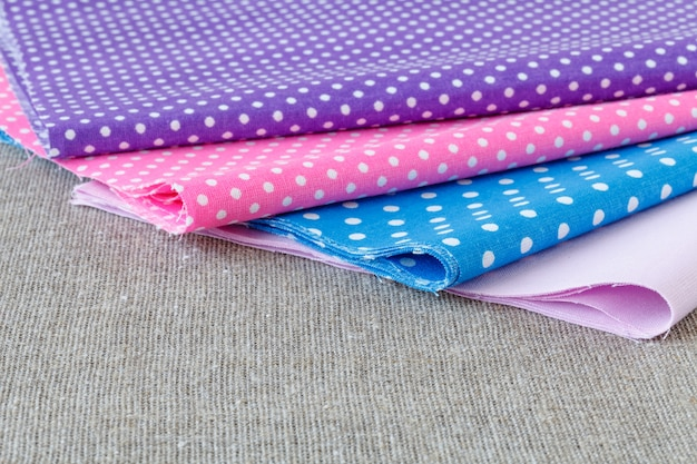 Colorful fabric samples on wooden table