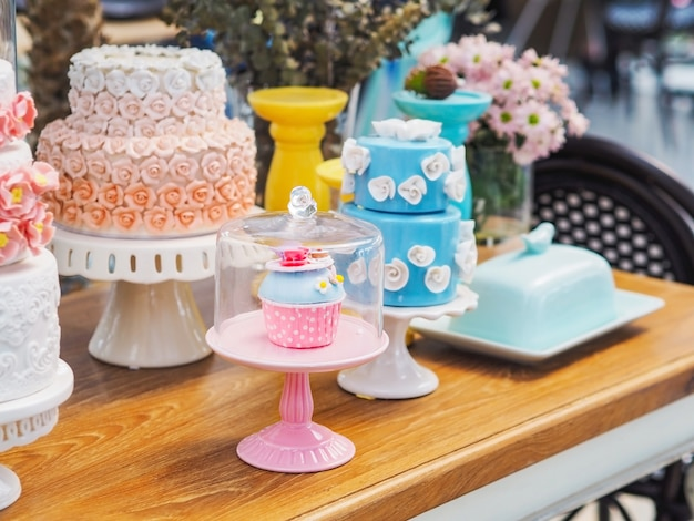 Colorful fancy cake on white cakestand