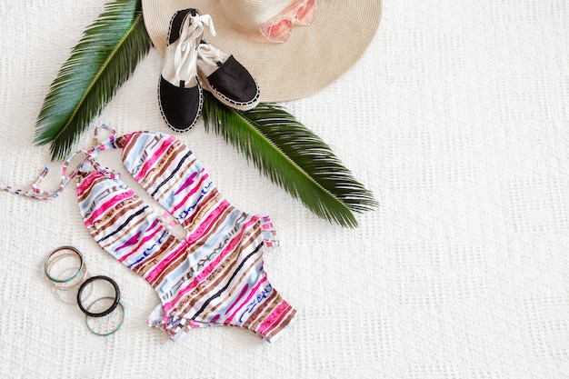 Colorful fashion women's summer swimsuit flat lay.
