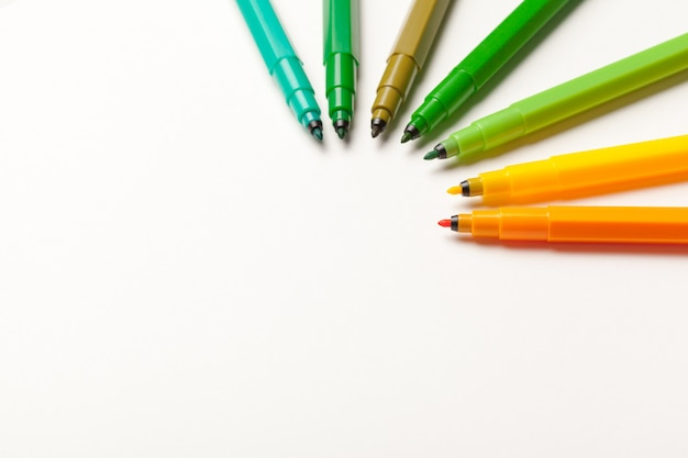 Colorful felt tip pens isolated on a white  close up