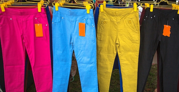 Colorful female trousers in the market