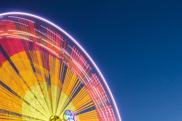 Colorful ferris wheel against the sky