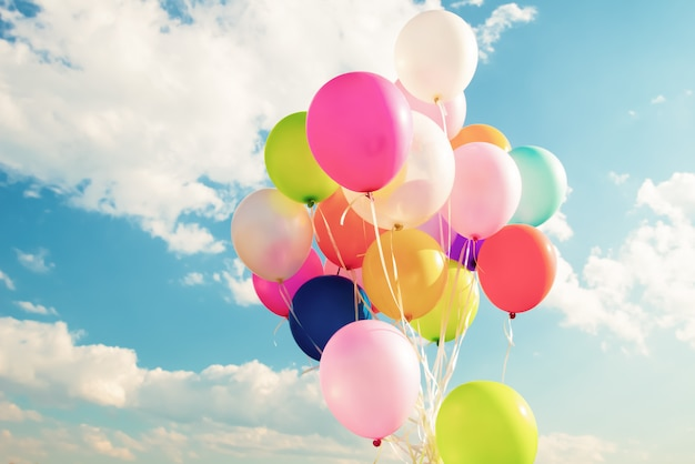 Colorful festive balloons over blue sky