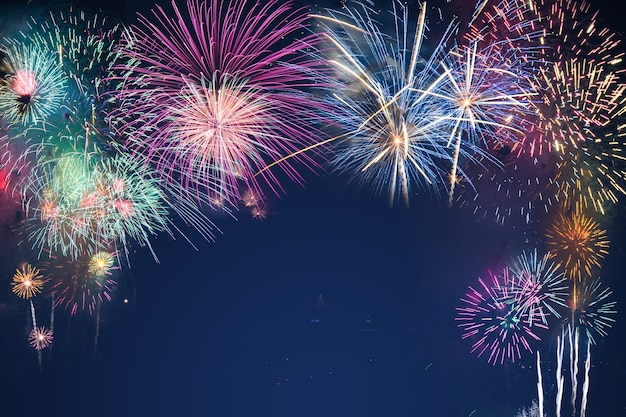 Colorful fireworks on the black sky background over-water Premium Photo