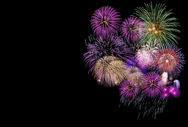 Colorful fireworks in black sky with copyspace