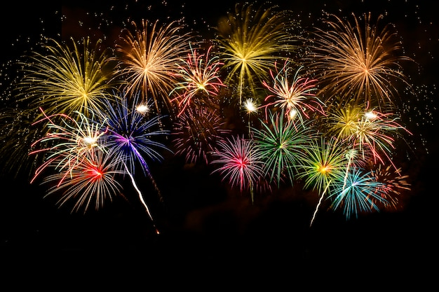 Colorful fireworks celebration on midnight sky.