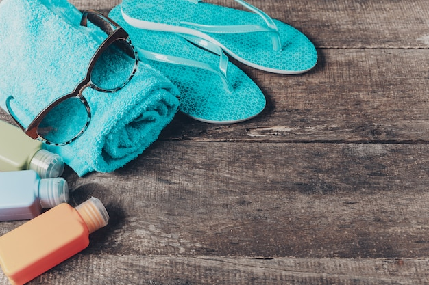 Colorful flip flops and straw hat, beach essentials