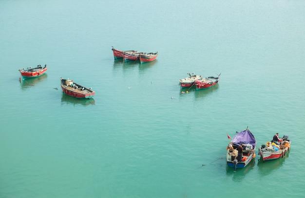 Colorful floating boats near skala du port. essaoura, morocco.