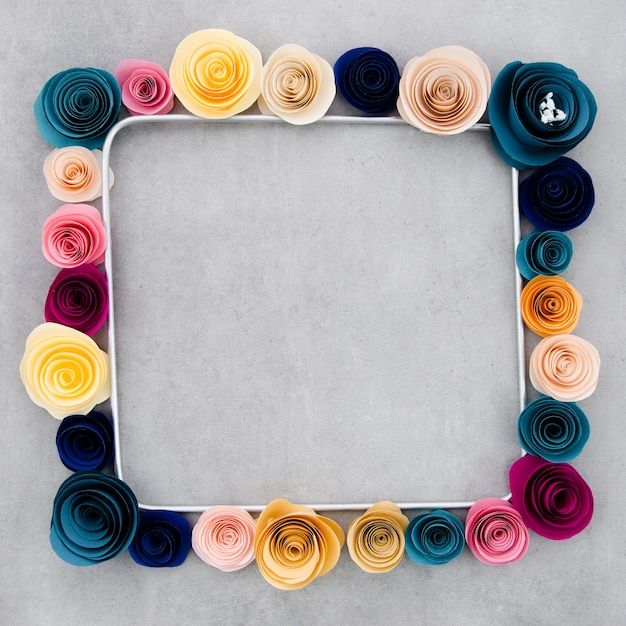 Colorful floral frame on cement background