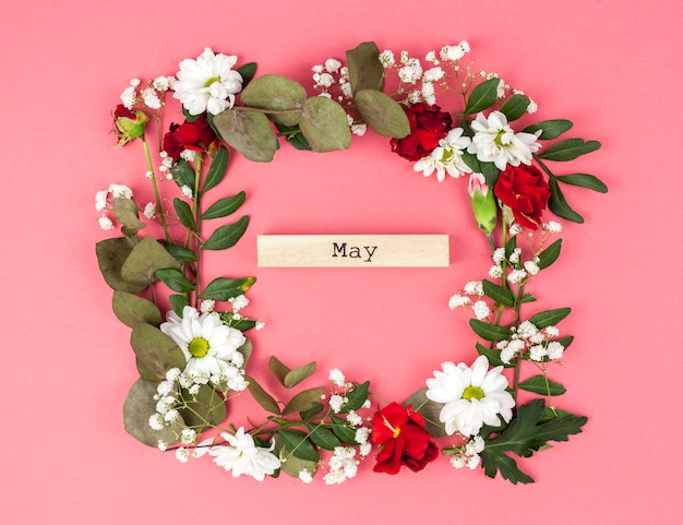 Colorful floral frame with may text on colored backdrop