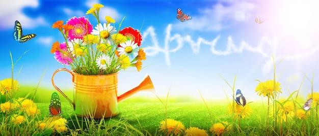 空に書かれた蝶と春のじょうろの色とりどりの花の花束