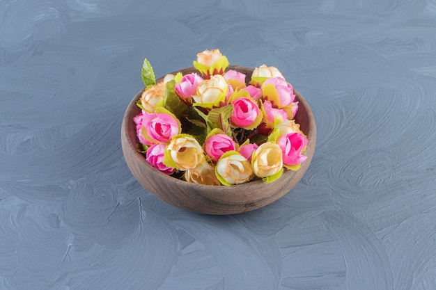 Colorful flowers in a bowl, on the white background.