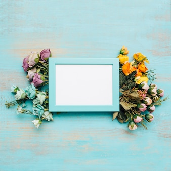 Colorful flowers with blue frame.