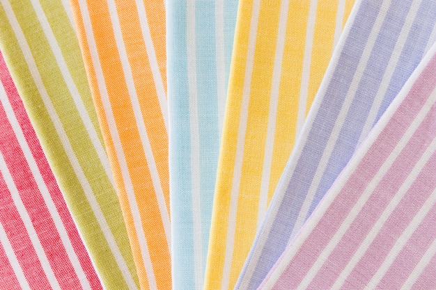 Colorful folded stripes pattern on fabric background