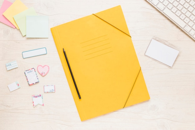 Colorful folder with notes on desktop