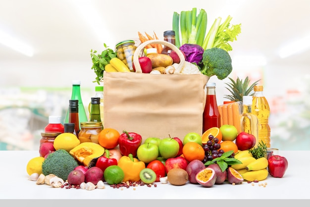 Colorful food and groceries on white countertop