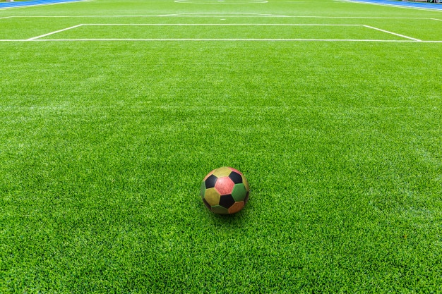 Colorful of football on football field or soccer field