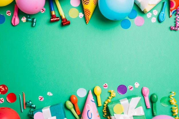 Colorful frame with party items on green background